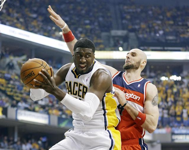 Indiana Pacers center Roy Hibbert, left, grabs a rebound in front of Washington Wizards center Marcin Gortat during the first half of game 2 of the Eastern Conference semifinal NBA basketball playoff series Wednesday, May 7, 2014, in Indianapolis. (AP Photo/Darron Cummings)