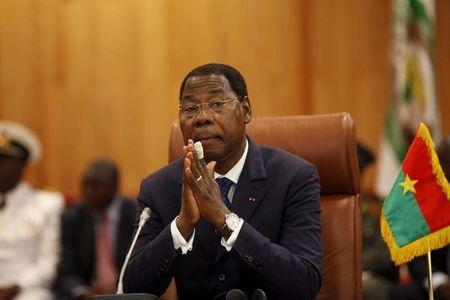 Benin's President Thomas Boni Yayi attends a ceremony marking the return of the transitional government in Ouagadougou