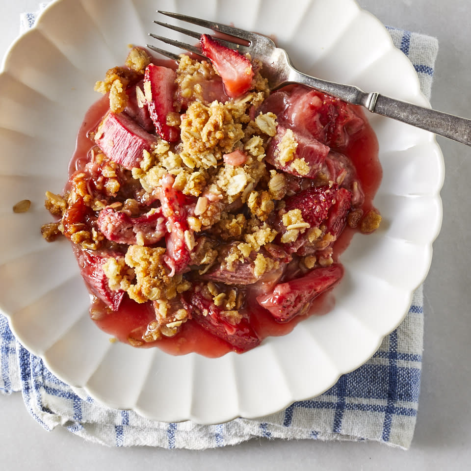"""<p>Tart rhubarb and sweet strawberries turn tender in their own juices beneath a brown sugar and oat crumble topping. This spring-inspired dessert comes together quickly without pie crusts to unroll; the tender fruit cooks quickly to make this a great last-minute dessert option too. Serve warm for the most luscious texture. <a href=""""http://www.eatingwell.com/recipe/270918/strawberry-rhubarb-cobbler-with-granola-streusel/"""" rel=""""nofollow noopener"""" target=""""_blank"""" data-ylk=""""slk:View recipe"""" class=""""link rapid-noclick-resp""""> View recipe </a></p>"""