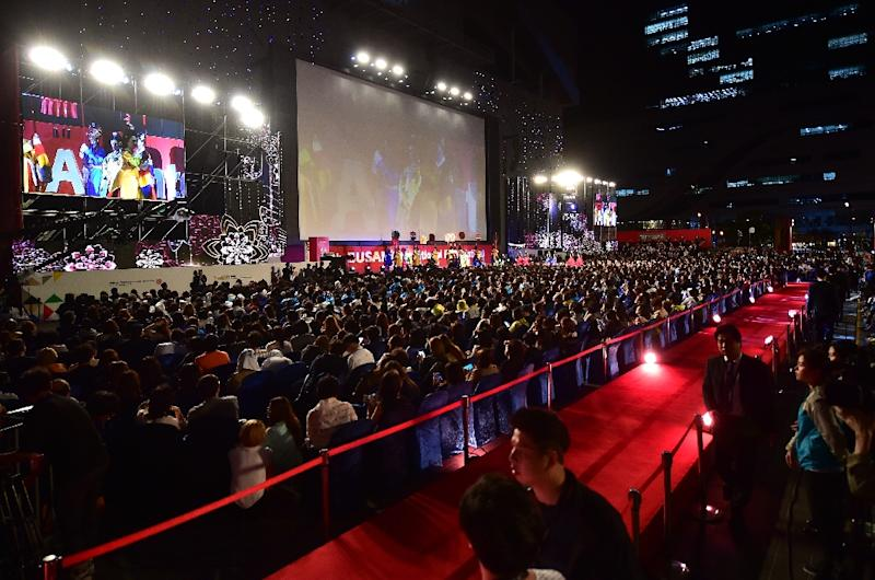 People attend the opening ceremony of the Busan International Film Festival (BIFF) at the Busan Cinema Center in Busan on October 1, 2015 (AFP Photo/Jung Yeon-Je)