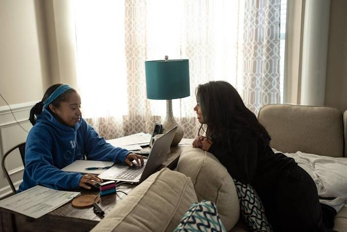 Jaylen Adams (right) talks to her mother, Carmen, on Monday, March 29, 2021 during an online study class in Charlotte, North Carolina.