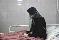 Covid-19 patient Marzieh Velaei breathes with oxygen mask at the COVID-19 ICU ward of Amir Al-Momenin hospital in the city of Qom, some 80 miles (125 kilometers) south of the capital Tehran, Iran, Wednesday, Sept. 15, 2021. (AP Photo/Vahid Salemi)