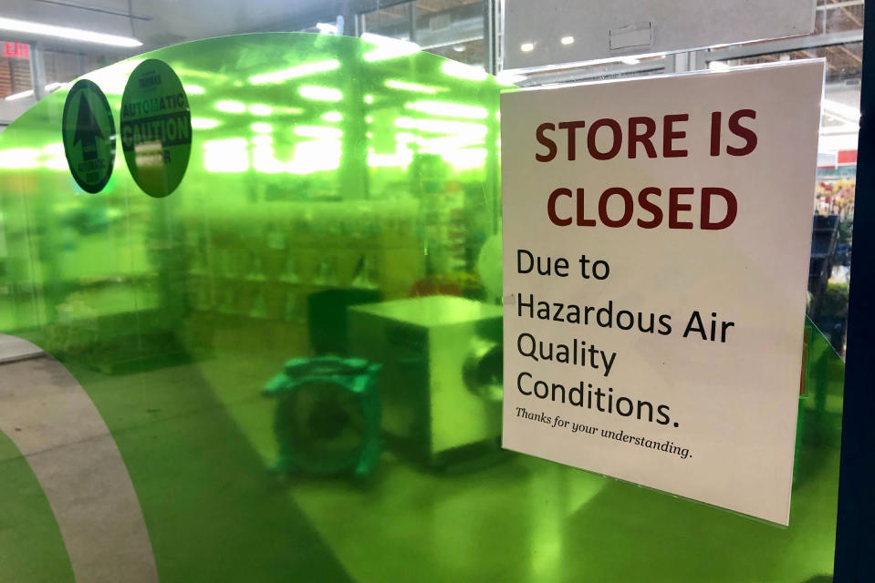 A sign at a Whole Foods in Lake Oswego, Ore., advises that the store is closed due to poor air quality Monday, Sept. 14, 2020. Another sign said all Whole Foods stores in the Portland Metro area will be closed at least through Thursday due to air quality. People across the West struggled under acrid-yellowish green smog from raging wildfires that seeped into homes and businesses, sneaked into cars through air conditioning vents and caused the temporary closure of iconic locations such as Powell's Books and the Oregon Zoo. And forecasters say the putrid air, measured as the worst on the planet, could last well into the week. (AP Photo/Gillian Flaccus)