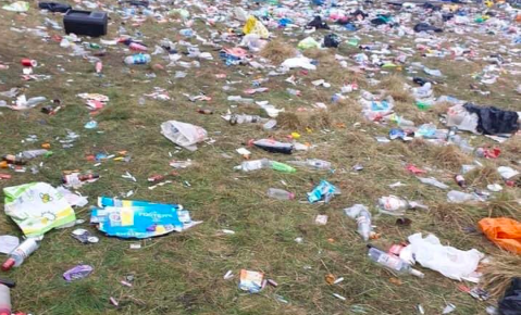 """The man had attended a gathering of around 4,000 in Oldham, according to Greater Manchester Police. On Sunday morning the park was littered with an """"atrocious"""" amount of rubbish according to volunteers who cleaned it. (PA)"""