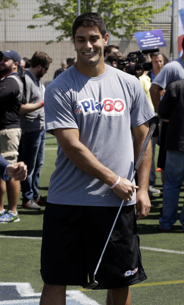 Eastern Illinois' Jimmy Garoppolo tries out his putting skills during an NFL event in New York, Wednesday, May 7, 2014. The event was to promote Play 60, an NFL program which encourages kids to be active for a healthy life. (AP Photo/Seth Wenig)
