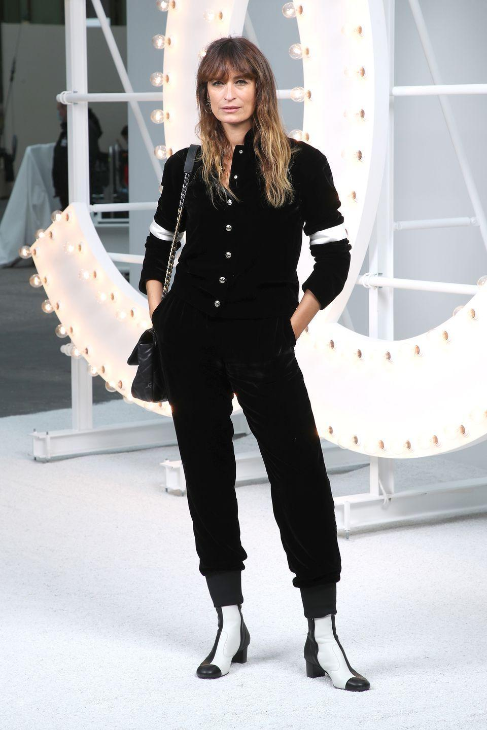 <p><strong>6 October </strong>Caroline de Maigret attended the show in a button-up shirt and matching trousers. </p>