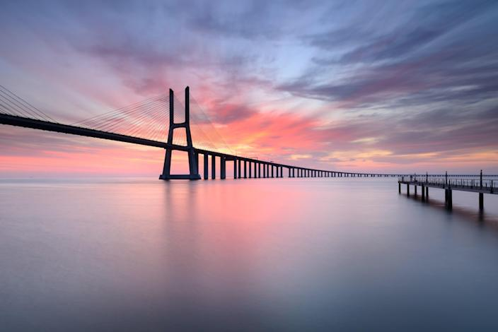 Portugal's <strong>Vasco da Gama Bridge</strong> is not just an architectural marvel; it also provides great views of the surrounding waters of the Tagus River. Located in Lisbon, the bridge runs some 56,381 feet, and was completed in 1998.