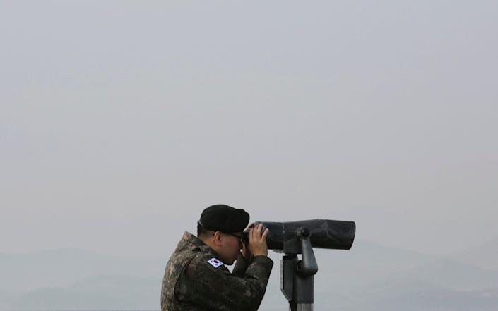 A South Korean soldier keeps an eye on the North. Tensions in the area have increased in recent weeks - AP