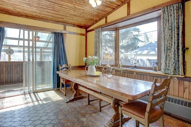 """<p><a href=""""https://www.zoocasa.com/parkhill-calgary-ab-real-estate/5231611-141-38a-av-sw-parkhill-calgary-ab-t2s0w4-c4176789"""" rel=""""nofollow noopener"""" target=""""_blank"""" data-ylk=""""slk:141 38A Avenue Southwest, Calgary, Alta."""" class=""""link rapid-noclick-resp"""">141 38A Avenue Southwest, Calgary, Alta.</a><br> The dining area has large windows, offering lots of light, and a walkout to the backyard.<br> (Photo: Zoocasa) </p>"""