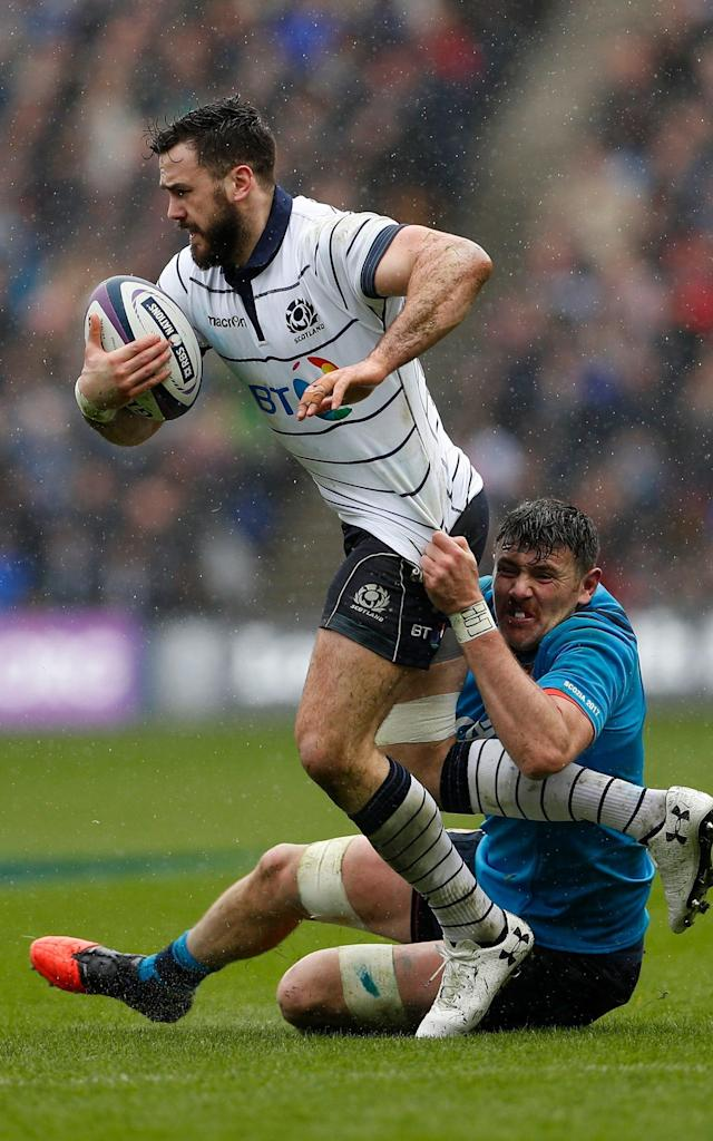 <span>Scotland centre Alex Dunbar attempts to break free from the Italian defence</span>
