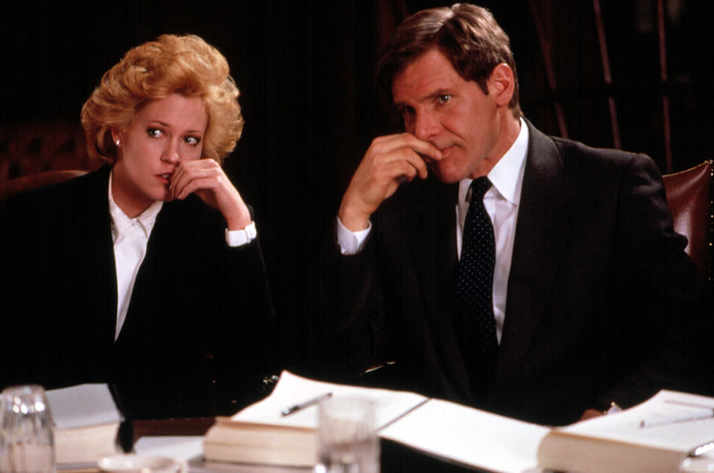 """<a href=""""http://movies.yahoo.com/movie/1800136897/info"""">Working Girl</a> (1988): A great example of Ford's capacity for romantic comedy. Yes, Mike Nichols' film is all about powerful women, with Melanie Griffith coming into her own as a big-haired secretary at a major Wall Street firm who takes over for her ailing boss (Sigourney Weaver). But the relationship she forges both professionally and personally with Ford's character, an investment banker who thinks she's really in charge, helps her confidence blossom. He's steady but also passionate, amusing and bemused, an imperfect Prince Charming. That may all sound like a contradiction, but it's that kind of versatility that makes Ford so enduring."""