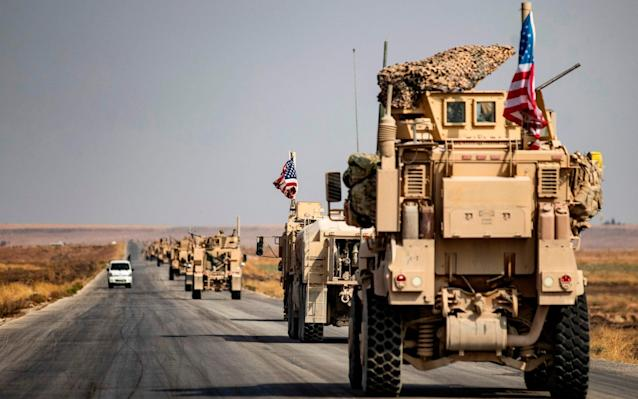 The first convoy of more than 70 vehicles left the Sarrin base on Sunday, headed for western Iraq - AFP