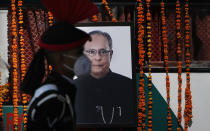 Veteran statesman, Pranab Mukherjee, who served as the President between 2012 and 2017, passed away on August 31, this year, aged 84. The former President was diagnosed with COVID-19, while in the hospital for removing a clot in his brain. <br>A leader respected across various spectrums of the political sphere and society, Mukherjee held several top portfolios including that of Finance and Defence. <br><em><strong>Image credit: </strong></em>An Indian army soldier wearing a face mask stands beside a portrait of Pranab Mukherjee during the cremation of the former Indian President in New Delhi, India, Tuesday, Sept. 1, 2020. (AP Photo/Manish Swarup)