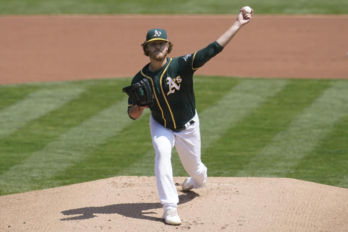 Oakland Athletics' Cole Irvin pitches against the Seattle Mariners during the first inning of a baseball game in Oakland, Calif., Tuesday, Aug. 24, 2021. (AP Photo/Jeff Chiu)