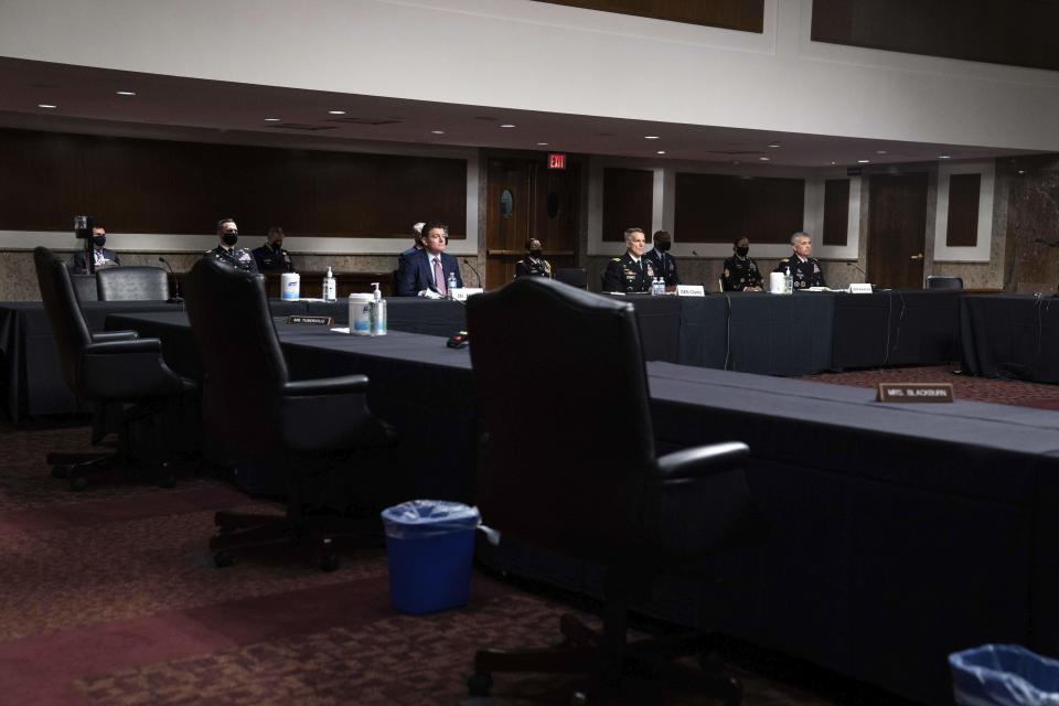 From left seated, Acting Assistant Secretary of Defense for Special Operations And Low-Intensity Conflict Christopher Maier, Special Operations Command Gen. Richard Clarke, U.S. Cyber Command Commander, and National Security Agency Director and Central Security Service Chief Gen. Paul Nakasone attend a hearing to examine United States Special Operations Command and United States Cyber Command in review of the Defense Authorization Request for fiscal year 2022 and the Future Years Defense Program, on Capitol Hill, Thursday, March 25, 2021, in Washington. (Anna Moneymaker/The New York Times via AP, Pool)