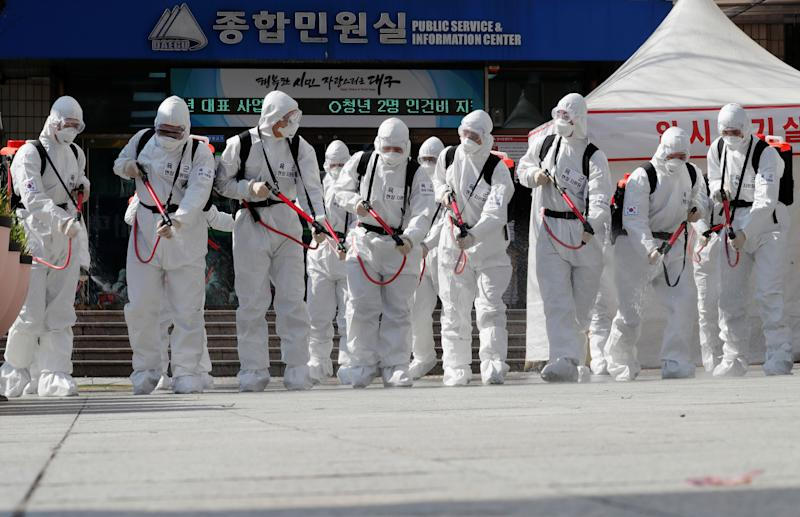South Korean soldiers wearing protective gear sanitize a city after the rapid rise in confirmed cases of the novel coronavirus disease of (COVID-19) in Daegu, southeast of the capital Seoul, South Korea, March 2, 2020. REUTERS/Kim Kyung-Hoon