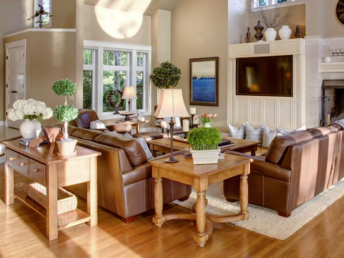living room skylight vaulted ceiling small rug matching couches tables