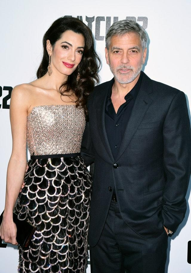 George Clooney and his wife Amal at the Catch-22 premiere