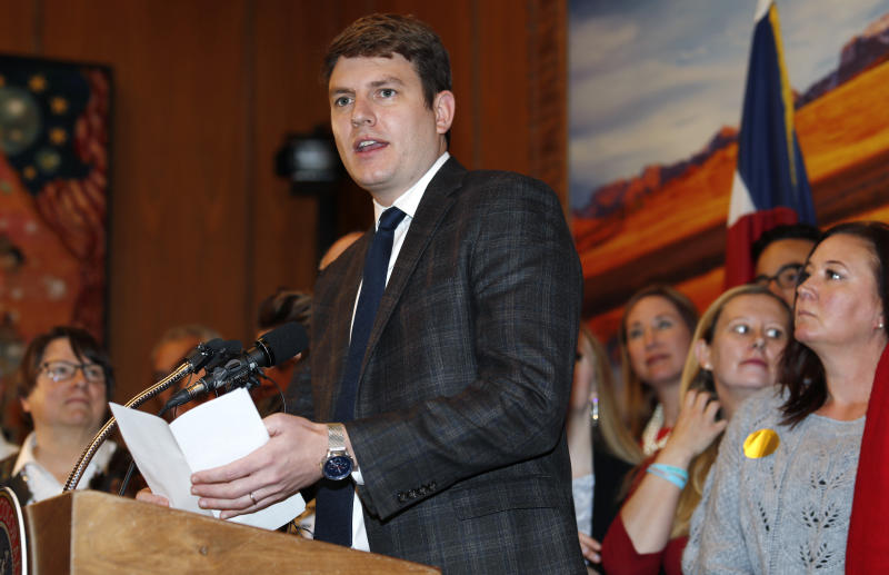 FILE--In this Friday, April 12, 2019, file photograph, Colorado Rep. Alec Garnett, D-Denver, speaks during a ceremony in the State Capitol in Denver. Garnett is co-sponsoring a proposal in the Legislature to dedicate a limited revenue stream from legalized sports betting to a state water conservation plan. Before that, though, voters will cast ballots Tuesday, Nov. 5, on whether to legalize sports betting in the state and tax the revenues to help conserve water. (AP Photo/David Zalubowski, File)