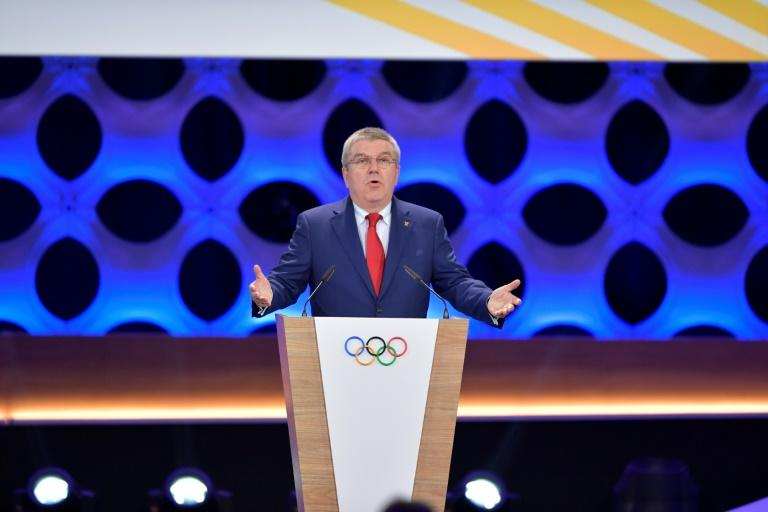 "International Olympic Committe President Thomas Bach (C) first signalled publicly that the double-award of an Olympics could be on the agenda in December 2016, lamenting that the bidding process produced ""too many losers"""