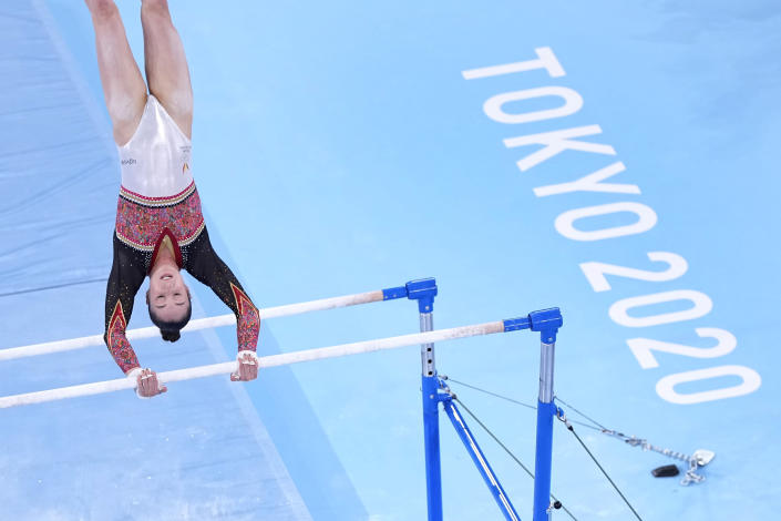 Nina Derwael, of Belgium, competes in the women's artistic gymnastics uneven bars final at the 2020 Summer Olympics, Sunday, Aug. 1, 2021, in Tokyo, Japan. (AP Photo/Jeff Roberson)
