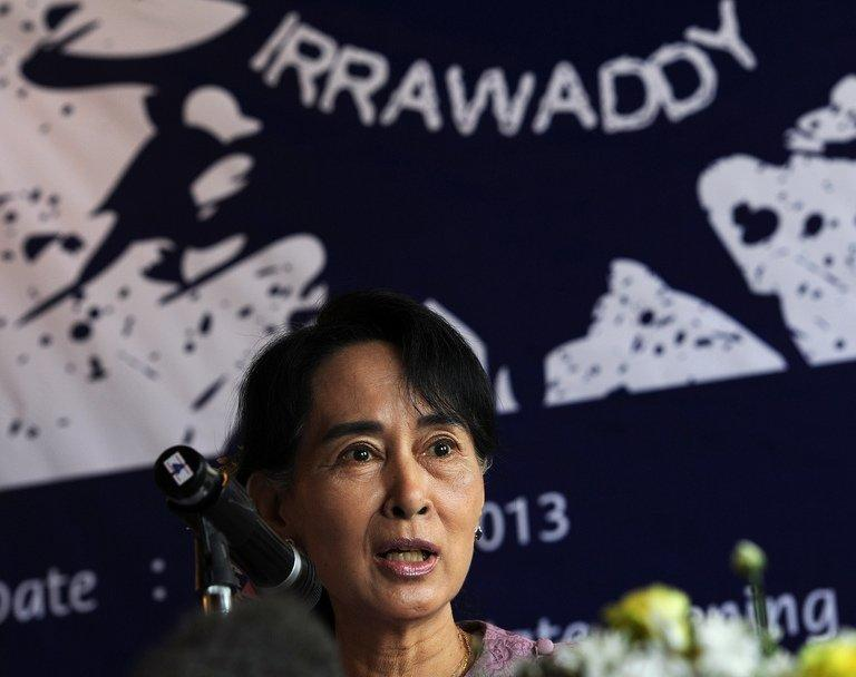 Aung San Suu Kyi speaks during the launch of the Irrawaddy Literary Festival at a hotel in Yangon on January 6, 2013