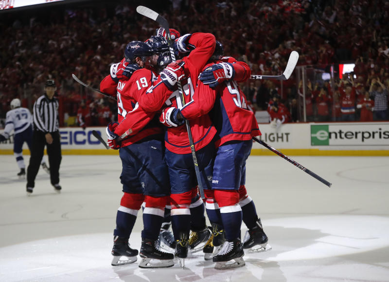 Washington Capitals right wing T.J. Oshie (77) celebrates with his teammates after scoring during the second period of Game 6 of the NHL Eastern Conference finals hockey playoff series against Tampa Bay Lightning, Monday, May 21, 2018, in Washington. (AP Photo/Pablo Martinez Monsivais)