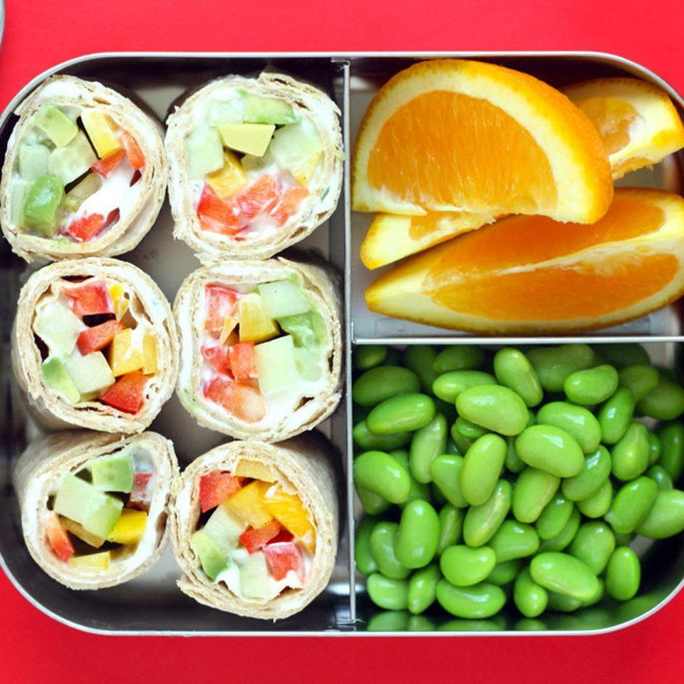 """<p>A sushi-like wrap of veggies and ranch dressing packaged in a tortilla makes an appealing lunch that kids will love. The choice of vegetables in the filling is flexible, depending on your child's preferences and what you have on hand. <a href=""""https://www.eatingwell.com/recipe/266991/veggie-sushi-bento-box/"""" rel=""""nofollow noopener"""" target=""""_blank"""" data-ylk=""""slk:View Recipe"""" class=""""link rapid-noclick-resp"""">View Recipe</a></p>"""