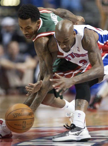 Milwaukee Bucks' Brandon Jennings, left, and Detroit Pistons' Walker Russell pursue a loose ball in the first quarter of an NBA basketball game on Friday, Feb. 3, 2012, in Auburn Hills, Mich. (AP Photo/Duane Burleson)