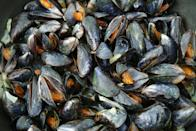 """<p>A rich source of low-calorie protein, mussels have been shown to reduce joint inflammation, says Chowdhury. They're also dripping with manganese and selenium for immunity, brain function and a healthy <a href=""""https://www.menshealth.com/uk/workouts/a33792405/leg-day-workout-metabolism-calories/"""" rel=""""nofollow noopener"""" target=""""_blank"""" data-ylk=""""slk:metabolism"""" class=""""link rapid-noclick-resp"""">metabolism</a>. Mussels are also relatively eco-neutral to farm – reassuring, given that seafood farming is one of the world's fastest-growing food production industries and increasingly unsustainable. Steam, bake in foil, or flour, fry and turn into """"popcorn"""".</p>"""