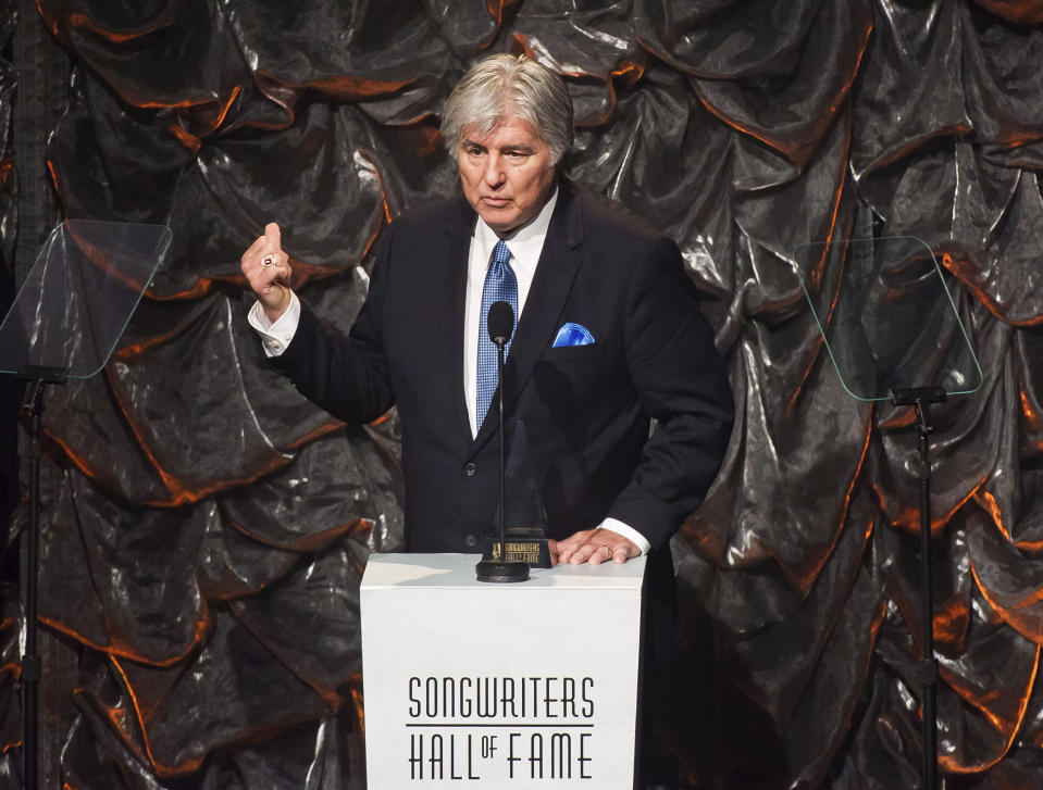 "FILE - In this June 12, 2014 file photo, Jim Weatherly speaks at the Songwriters Hall of Fame Awards in New York. Weatherly, who wrote hit songs like ""Midnight Train to Georgia,"" has died. He was 77. (Photo by Charles Sykes/Invision/AP, File)"