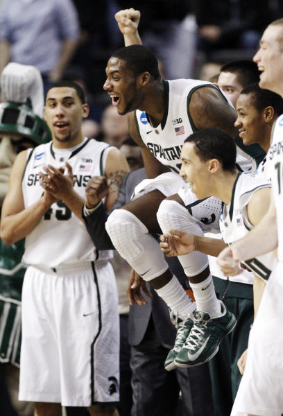 Michigan State forward Branden Dawson (22) jumps around after a defensive play by a teammate late in a third-round game of the NCAA college basketball tournament against Memphis, Saturday, March 23, 2013, in Auburn Hills, Mich. Michigan State won 70-48. (AP Photo/Duane Burleson)