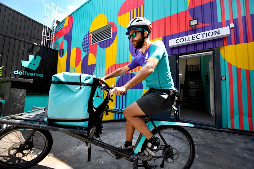 Changing working habits: A biker working for the Food delivery service Deliveroo cycles off to deliver an order on July 3, 2018 in Saint-Ouen, outside Paris. Photo: GERARD JULIEN/AFP/Getty Images