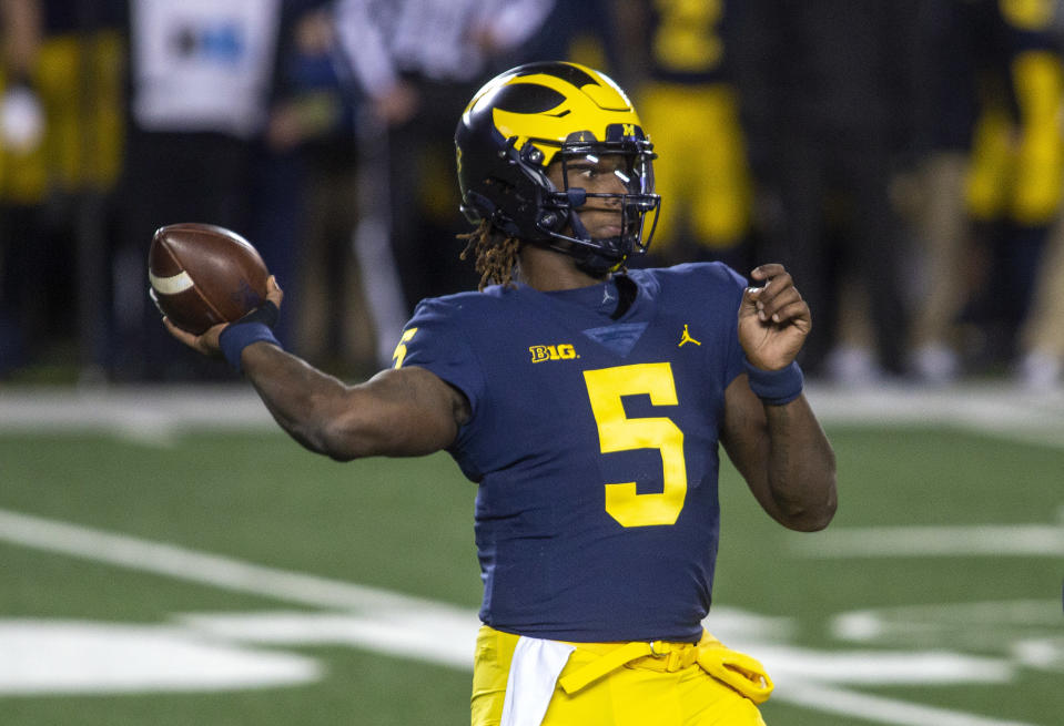 Michigan quarterback Joe Milton throws a pass during the first quarter of the team's NCAA college football game against Wisconsin in Ann Arbor, Mich., Saturday, Nov. 14, 2020. (AP Photo/Tony Ding)