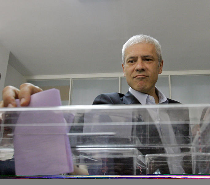 Democratic Party leader and former president Boris Tadic casts his ballot at a polling station in downtown Belgrade, Serbia, Sunday, May 6, 2012. Serbia, a landlocked nation of 7.1 million people in southeast Europe, is holding presidential, parliamentary and municipal elections Sunday. Whoever wins could affect Serbia's future relations with the European Union as well as Kosovo, a one-time province whose declaration of independence Serbia has refused to accept.(AP Photo/Darko Vojinovic)