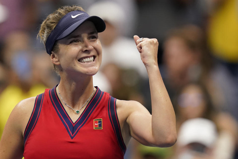 Elina Svitolina, of Ukraine, reacts after defeating Simona Halep, of Romania, during the fourth round of the US Open tennis championships, Sunday, Sept. 5, 2021, in New York. (AP Photo/Seth Wenig)