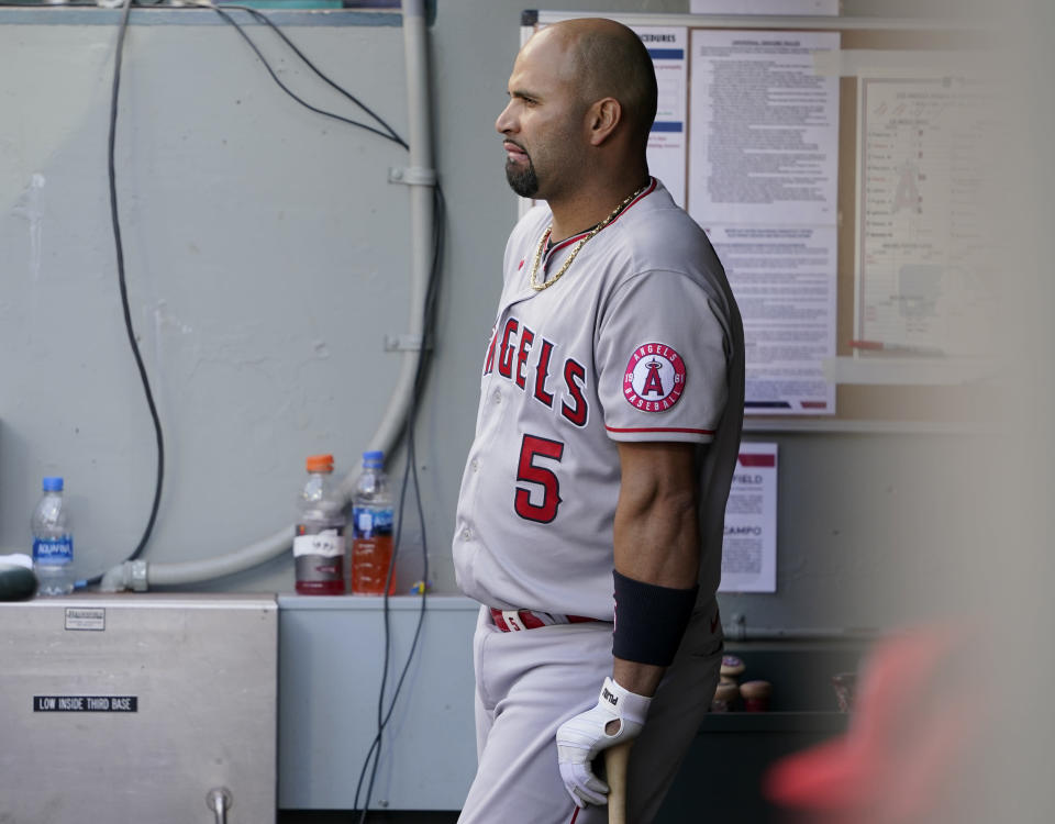 Los Angeles Angels Albert Pujols leans on his bat in the dugout during the eighth inning of a baseball game against the Seattle Mariners, Sunday, May 2, 2021, in Seattle. (AP Photo/Ted S. Warren)