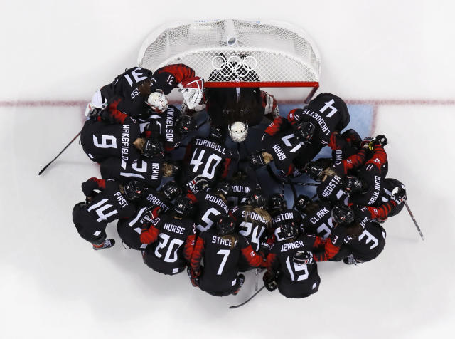<p>Players from Canada gather before the preliminary round of the women's hockey game against Finland at the 2018 Winter Olympics in Gangneung, South Korea, Tuesday, Feb. 13, 2018. (AP Photo/Matt Slocum) </p>