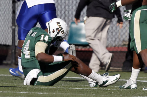UAB quarterback Jonathan Perry (14) sits on the ground after throwing an interception that was run back for a touchdown during the second half of an NCAA college football game against Middle Tennessee State on Saturday, Nov. 2, 2013, in Birmingham, Ala. (AP Photo/Butch Dill)