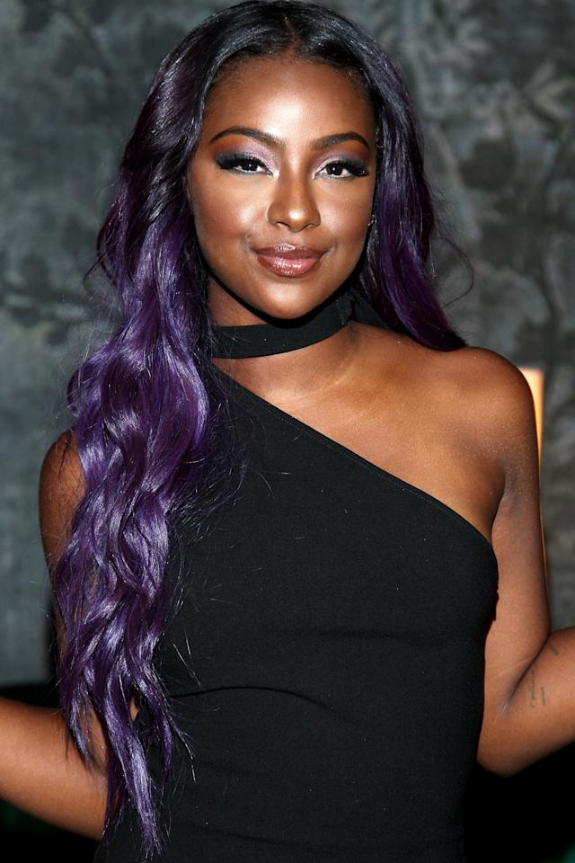 <p>Justine's purple hair is part of her signature look. But whether she wears her hair styled in loose waves, sleek braids or volumized curls, her dark roots are always present.</p>
