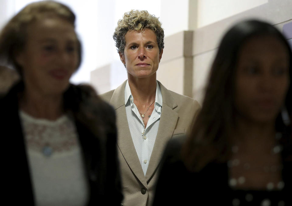 FILE - In this Sept. 24, 2018 file photo, accuser Andrea Constand returns to the courtroom during a lunch break at the sentencing hearing for Bill Cosby at the Montgomery County Courthouse in Norristown, Pa. Cosby, 83, has spent more than two years in prison since he was convicted of drugging and sexually assaulting Constand, a Temple University employee he had taken under his wing, in 2004. Now the Pennsylvania Supreme Court is set to hear his appeal of the conviction on Tuesday, Dec. 1, 2020. The arguments will focus on the trial judge's decision to let five other accusers testify for the prosecution. (David Maialetti/The Philadelphia Inquirer via AP, Pool)