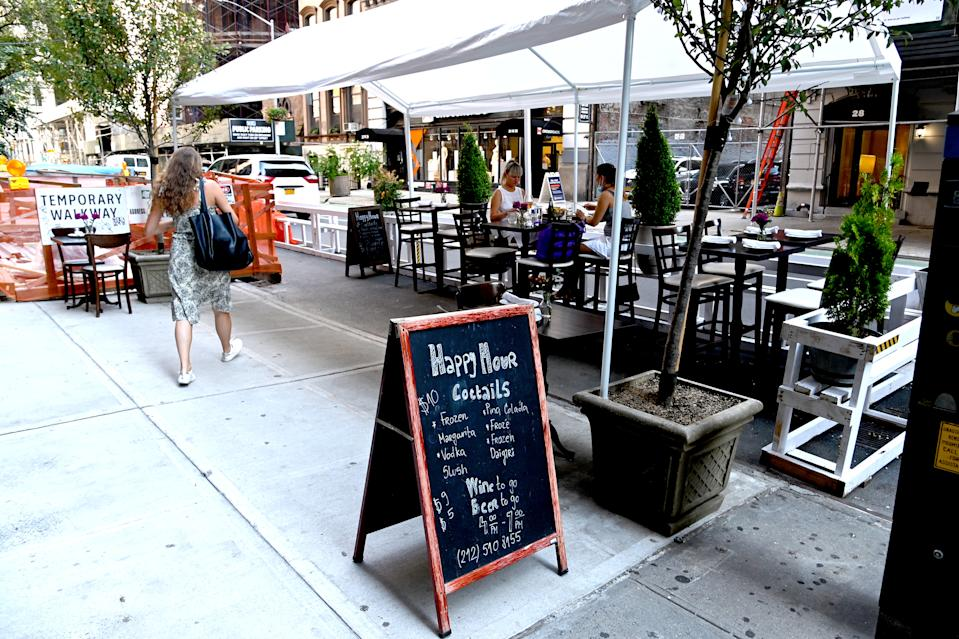 NEW YORK - JULY 27: An outdoor dining area is seen as the city continues Phase 4 of re-opening following restrictions imposed to slow the spread of coronavirus on July 27, 2020 in New York City. Many restaurants have built outdoor seating on the streets in order to allow for social distancing between patrons. The fourth phase allows outdoor arts and entertainment, sporting events without fans and media production. (Photo by Jamie McCarthy/Getty Images)