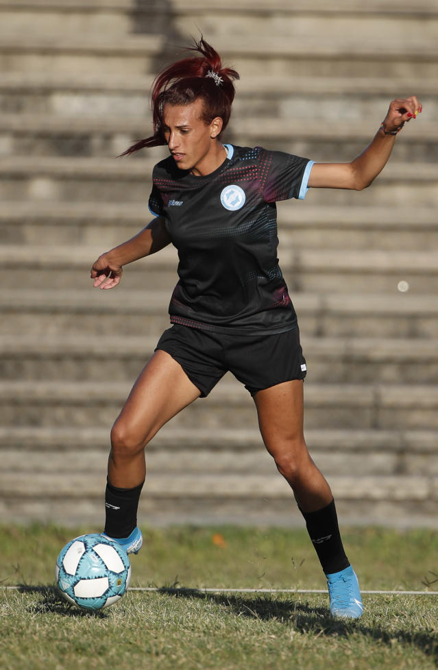 Soccer player Mara Gomez trains with her first division women's soccer team, Villa San Carlos, in La Plata, Argentina, Wednesday, Feb. 12, 2020. Gomez is a transgender woman who is limited to only training with her team while she waits for permission to start playing from the Argentina Football Association (AFA). If approved, she would become the first trans woman to compete in a first division, professional Argentine AFA tournament. (AP Photo/Natacha Pisarenko)