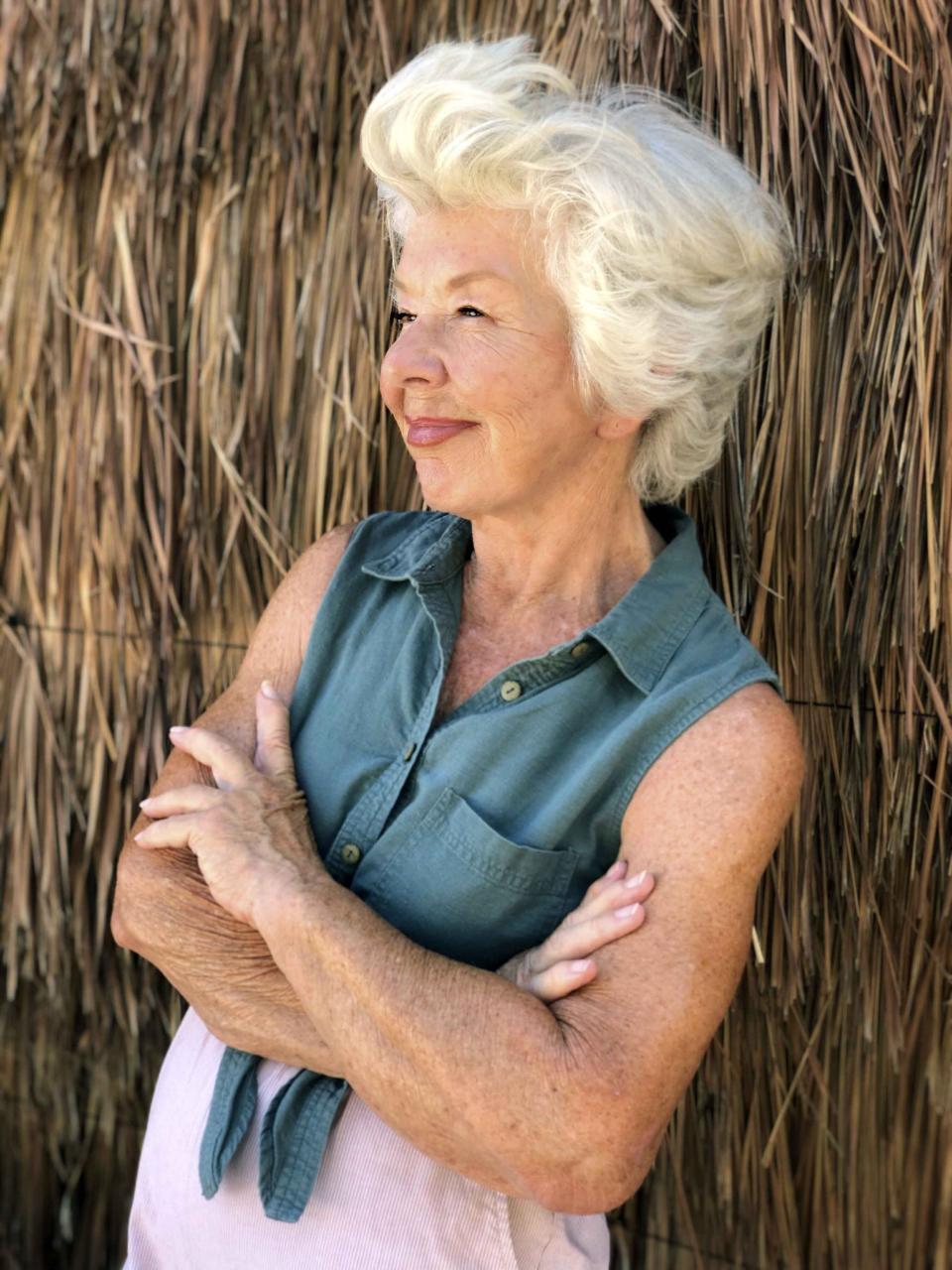 """This photo shows Joan MacDonald, 75, in Tulum, Mexico, on Sept. 1, 2020. MacDonald is among a growing number of """"grandfluencers,"""" folks 70 and up who are making names for themselves on social media. (Michelle MacDonald via AP)"""