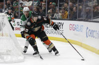Anaheim Ducks' Pontus Aberg (20) is defended by Dallas Stars' Gavin Bayreuther during the second period of an NHL hockey game Wednesday, Dec. 12, 2018, in Anaheim, Calif. (AP Photo/Marcio Jose Sanchez)