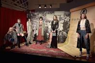 <p>Models in front of the rewritten Bill of Rights geared toward women's rights at the Alice + Olivia FW18 presentation. (Photo: Getty Images) </p>