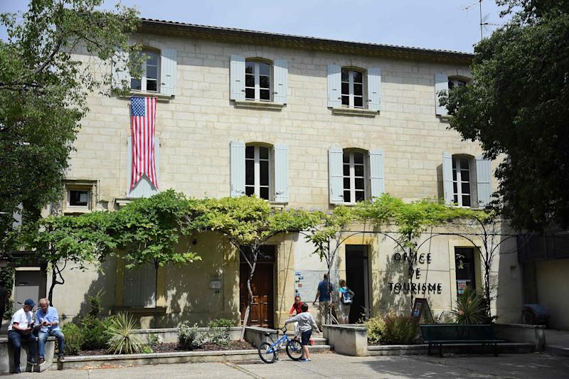 The U.S. flag is displayed on the tourist office of Villeneuve-les-Avignon, in the south of France on June 15, 2019, as former President Barack Obama and his family spends the week in Avignon on vacation.