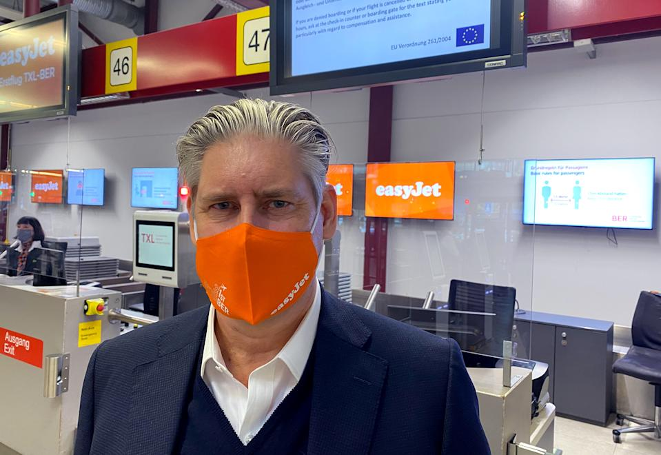 EasyJet CEO Johan Lundgren poses at check in before boarding a flight to new Berlin-Brandenburg Airport (BER) in Schoenefeld, taking off from Berlin Tegel (TXL) airport in Berlin, Germany, October 31, 2020.     REUTERS/Klaus Lauer