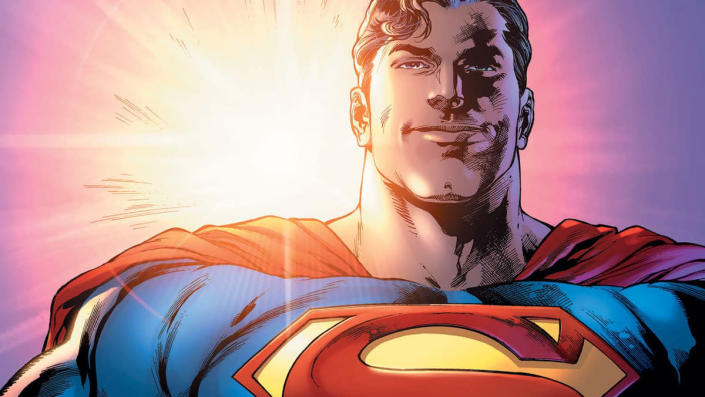 Superman smiling in front of a sunset