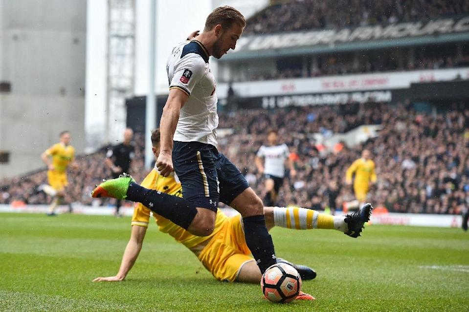 Tottenham Hotspur's Harry Kane is sidelined for several weekswith ankle ligament damage sustained against Millwall in the FA Cup quarter-finals (AFP Photo/Glyn KIRK )